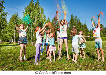Kids playing with colored powder at outdoor fest