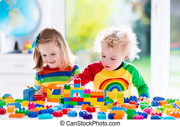 Kids playing with colorful plastic blocks - Child playing...