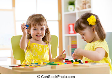 kids playing with developmental toys at home or kindergarten...