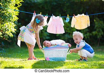 Kids playing with newborn baby brother