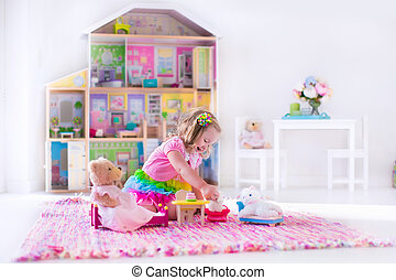 Kids playing with stuffed animals and doll house
