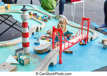 kids playing with toy railway road