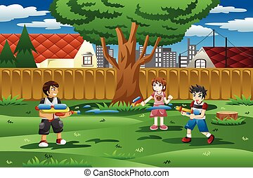 Kids playing with water gun in the backyard