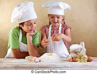 Kids preparing a cake - starting with flour and eggs - Kids...