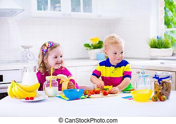 Kids preparing breakfast in a white kitchen