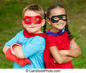 Kids pretending to be superheroes - Pretty mixed race girl...