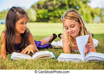 Kids Reading Books - Cute Little Girls Reading Books Outside...