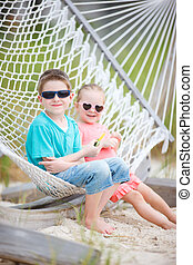 Kids relaxing in hammock