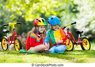 Kids ride balance bike in park - Children riding balance...