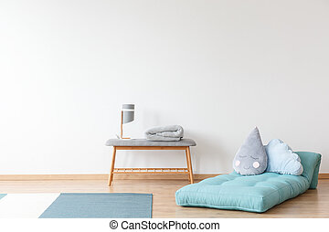 Kid's room with blue mattress
