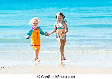 Kids run and play on tropical beach - Happy kids play, run...