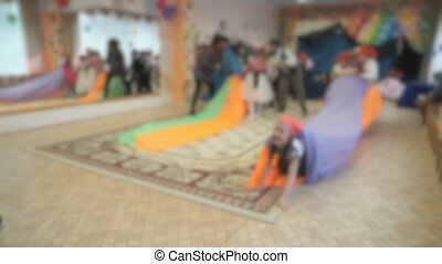 Kids run, play educational games in the hall