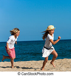 Kids running after each other.