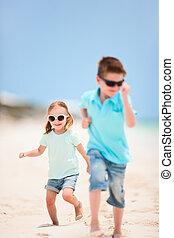 Kids running at beach