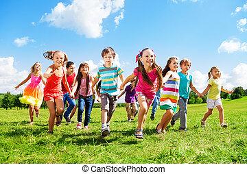 Kids running enjoying summer - Many different kids, boys and...