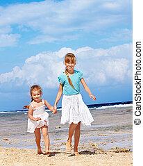 Kids running on beach.