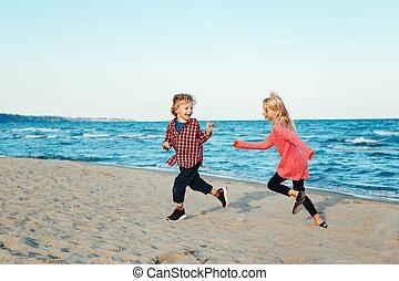 Kids Running On Beach Water