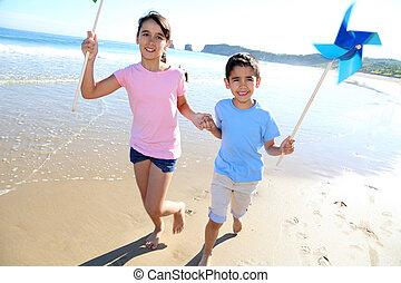 Kids running on the beach with swirls