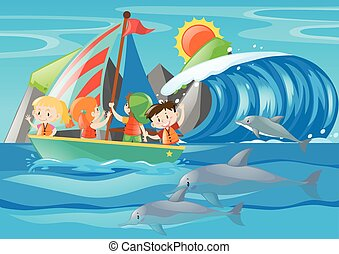 Kids sailing and dolphin in the ocean