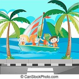Kids sailing boat in the ocean