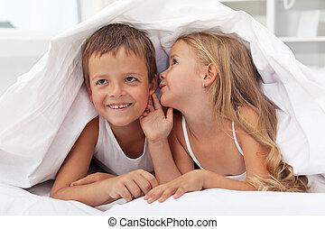 Kids sharing their secrets under the quilt
