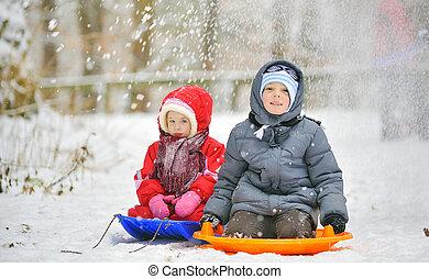kids sit on sled
