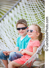 Kids sitting in hammock