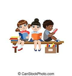 Kids Sitting On The Desk Reading