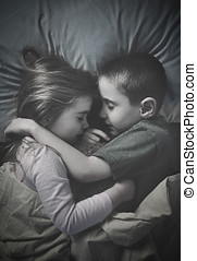 Kids Sleeping Together at Night in Bed - Two little kids are...