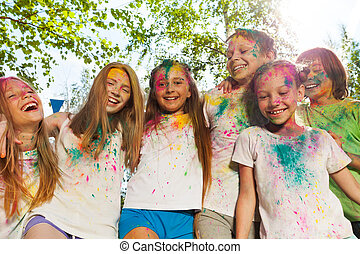 Kids smeared with colored powder on the color fest