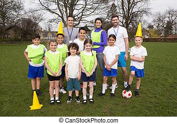 Kids Soccer Team - A group portrait of a kids soccer team,...