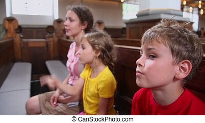 Kids speak with mother about religion when they sit in church