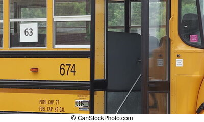 Kids students getting on bus