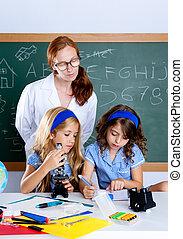 kids students with nerd teacher woman at school