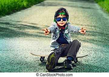 kids style - Cool 7 year old boy with his skateboard on the...