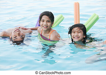 kids swimming - Children having fun in swimming pool
