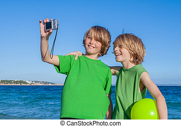 kids taking selfie on holiday in Mallorca Spain
