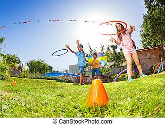 Kids target practice with hula hoops rings game