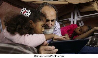 Kids teaching grandpa to use smart gadget - Beautiful kids...