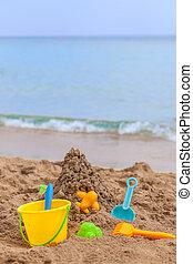 kids toys on tropical sand beach