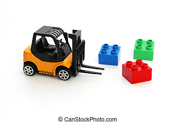 Kids toys. Yellow forklift toy ships color cubes.