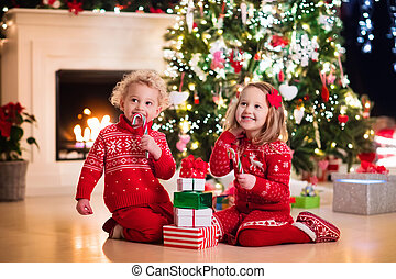 Kids under Christmas tree - Happy little kids in matching...