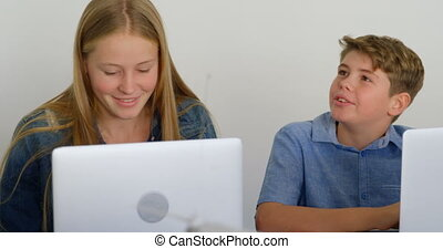 Kids using laptop in training institute 4k - Happy kids...