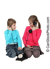 Kids using old-fashioned telephone