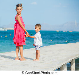 Kids walking on jetty
