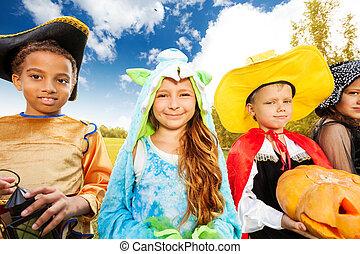 Kids wear Halloween costume outside in park