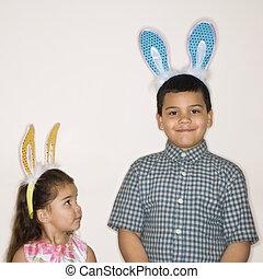 Kids wearing bunny ears.