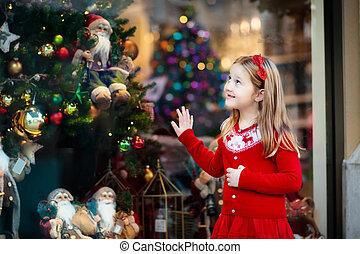 Kids window shopping. Christmas presents. Xmas gifts. - Kids...