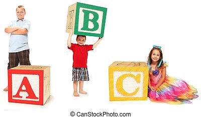 Kids with ABC in Alphabet Blocks