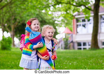 Kids with candy cone on first school day in Germany - Child...
